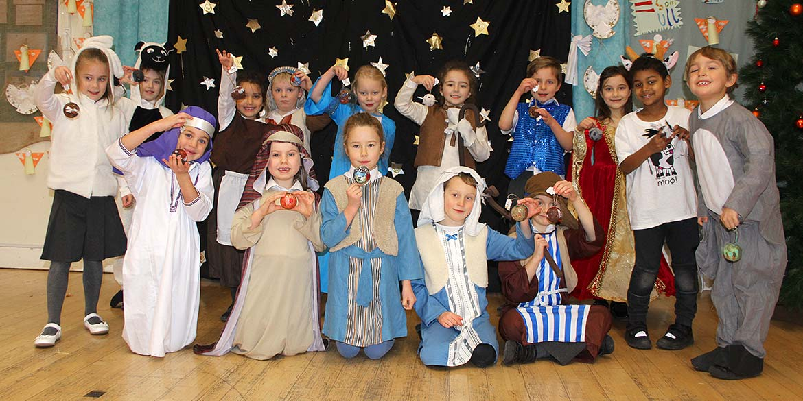 Children from Walton on the Hill Primary School create hand decorated Christmas baubles